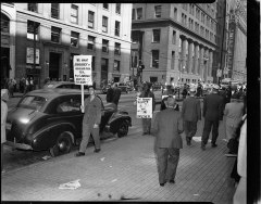 Men protesting segregated pools in Pittsburgh, PA in 1949.